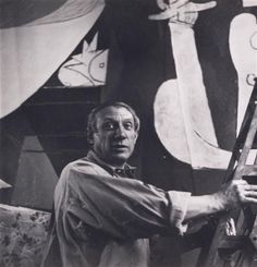 "Pablo Picasso painting the ""Guernica"" in his atelier of ""Grands-Augustins"". Picture published in 1937 in Cahiers d ' Art, vol. 12. -- Picasso Museum, Paris."
