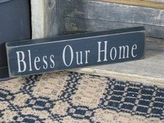 Our 'Bless our Home' wood sign is a perfect accent to your primitive decor. It's black with khaki stenciling and goes with decor from Primitive Star Quilt Shop. https://www.primitivestarquiltshop.com/collections/wood-signs/products/bless-our-home-wood-sign #primitivefarmhousedecor