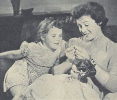 mother teaching daughter to sew household responsibilities