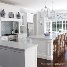 white marble kitchen white cabinetry nickel pendanYou can find Pendants and more on our website. Beach House Kitchens, Home Kitchens, Farmhouse Kitchens, Dream Kitchens, Blue Subway Tile, Hamptons Kitchen, White Marble Kitchen, New Kitchen Cabinets, Kitchen Reno