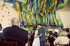 crepe paper canopy at a wedding ceremony or for the head table. would love to see it in citrus colors (yellow, orange, tangerine, peach, etc). @Luisa D.P. Morgan?