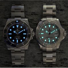 lume shot of the no date Rolex submariner and platinum Rolex Yacht Master