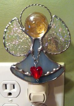 Angel holding a heart nightlight