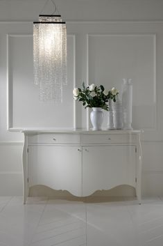 As comfortable in a dining room, bedroom or study as it is as a welcome in an entrance hallway. The Contemporary Designer White Lacquered Sideboard with 2 soft close drawers, double cabinet doors and internal central shelf can be found at Juliettes Interiors. A truly stunning statement indeed for any room in the house. Striking in any setting, the ultimate in a stylish and glamorous storage solution.