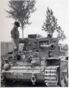 An SS Panzer crewman of Schwere SS-Panzer-Abteilung 101 checking out Cromwell tank 'Shufti Cush' at Villers-Bocage. The Cromwell was one of the many British tanks destroyed by Michael Wittmann (I'm pretty sure about that) during his famous rampage on June Military Armor, Military Guns, Military Vehicles, Canadian Army, British Army, British Tanks, Panzer Iv, Cromwell Tank, Tank Warfare