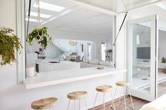 White indoor outdoor dining space with wide gas strut servery window | NONAGON.style