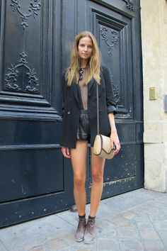 Black blazer, black sheer top, leather shorts.