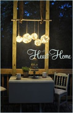 Easy DIY Outdoor Chandelier - All Things Heart and Home - Outdoor lighting made with grapevine orbs plus twinkle lighting and strung on a straight limb or rod. Outdoor Chandelier, Diy Chandelier, Outdoor Lighting, Outdoor Decor, Lighting Ideas, Balcony Lighting, Outdoor Balcony, Iron Chandeliers, Balcony Ideas
