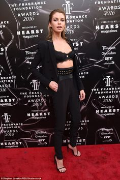 Sexy Stella! The Victoria's Secret Model wore slender black slacks, paired with a belt and...