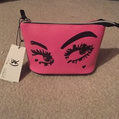 "Cute ""flirty eyes"" makeup back! New with tags Pink travel size make up bag. 8x5 Bags"