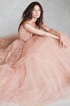 Strong blush a-line/ball gown with straps and plunging neckline. Crystal embroidered exentuating the natural waist. Stunning!