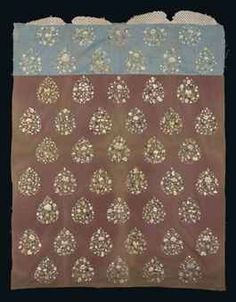 A LARGE CENTRAL ASIAN EMBROIDERED SILK PANEL  LATE 13TH OR 14TH CENTURY  The sang-de-boeuf field comprising three panels of plain silk with applied upper light blue similar panel, both embroidered in coloured silks with diagonal drop-shaped panels each with a different floral arrangement, applied upper plainwoven ivory band with simple brown geometric repeat, light staining along fold lines, otherwise excellent condition 80¼ x 64 in. (204 x 162.3cm.)
