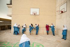 A group of third-graders at a very high-end private school in northern Tehran play Sangsar (stoning), a similar game to dodgeball, except that kids would line up against the ball and one person would shoot out the ball at others on November 13,2011. According to Islamic Shi'a law in Iran, when a girl turns nine years old she is considered to be mature enough to take on life and her religious responsibilities. But the definition of these responsibilities varies throughout the country(Kiana…