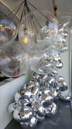 "Stunning organic garland built from 18"" silver circle foil balloons."