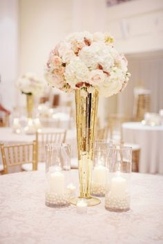 Tall mercury glass centerpieces (if not using gold table clothes)