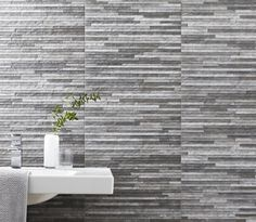 Brix Stratum Anthracite Wall Tile love this. Has look of split face tiles but it's not, and waterproof, doesn't need sealing