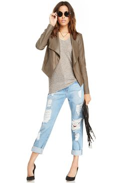 Creating a casual, yet effortlessly contemporary look can be simple when you pair just the right items together. Take the ever so versatile Dolman knit top and wear it with a pair of distressed denim jeans. Top it off with a leather jacket with oversized lapels to complete the look.