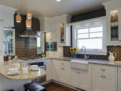 Brown: Subway Tile Backsplash - 30 Bright, Bold and Colorful Kitchens on HGTV need the corner cabinet holding the microwave