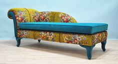 The classic design upholstered with gobelin and turquoise velvet fabrics. Beautiful combination of lovely colors; wood legs are covered with