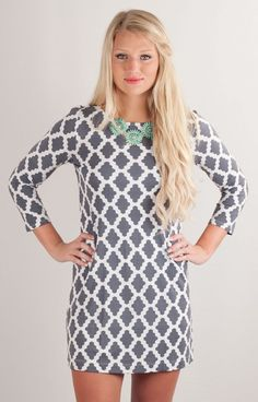 So soft... so sweet! Hourglass Lilly grey and white tunic dress is a classic approach to the warmer weather outside. Simple and flattering, these dresses highlight your figure just where you want it to.