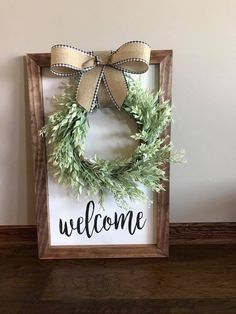 Adorable farmhouse style welcome sign with wreath