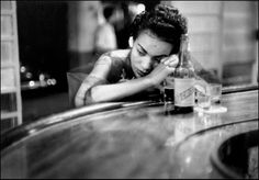 Eve Arnold - Bar girl in a brothel in the red light district. Havana, Cuba 1954