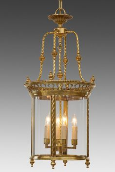 "Cast brass and glass rope and cut out design four light lantern. Shown in custom satin gold finish. Style LL-79.  29.75"" H x 13.5"" W x 13.5"" D  Available in other sizes and custom finishes."