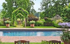 Lovely landscaping surrounds this pool area. What a wonderful place to relax on a hot day! - Traditional Home ® / Photo: Matthew Benson