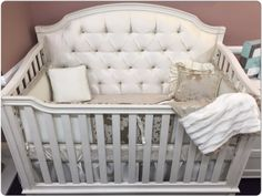 Looking for something different for your nursery? How about a hand tufted convertible crib with crystals?