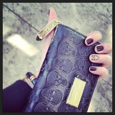 @Kristen Davies Nino has a skull-tasitc wallet!