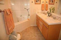 Small master bathroom, combined corner tub and shower
