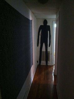 Hang this pleasant fellow made out of craft paper at the end of a dark hallway. | 23 Fun Ways To Scare Your Kids This Halloween