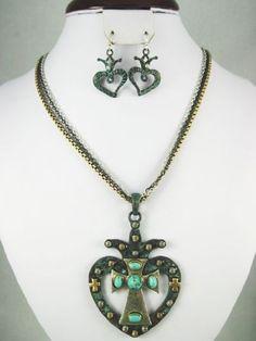 Accessory Accomplice Turquoise Patina Metal Heart & Silvertone Cross Pendant Necklace & Earring Set Accessory Accomplice http://www.amazon.com/dp/B00AL2N2RU/ref=cm_sw_r_pi_dp_WMn-tb1CTVKXN