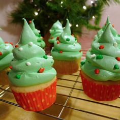 Christmas Tree Cupcakes | SimplyCelebrate.Meals.com - These frosting swirled #Christmas Tree Cupcakes have GOBSTOPPER toppers and a dash of NERDS for ultimate delicious fun. #simplycelebrate
