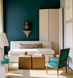 love the wall color with the crisp white and black/white pillow.