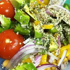 Almost fully raw lunch. Chickpeas, tomato, cucumber, red onion, peppers, balsamic, hemp seeds and avocado.