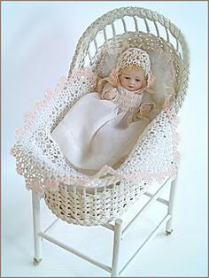Porcelain doll by Jean Pardina  Hand tatted blanket and bonnet by Esther Hargrove  Baby dress by Monica Roberts