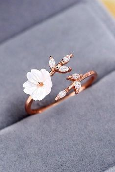 Spring Wedding Sakura Blossom Ring  This beautiful ring can help pull your whole wedding aesthetic together. With a flower made from shell, leaves decorated with zircon gems, and a rose gold band made to look like a branch wrapping around your finger, this ring is both nostalgic and modern. #wedding #sakura #cherry #flower #floral #ring #jewelry #diyprojects
