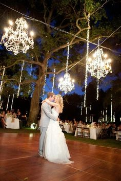 Chandeliers hanging from trees at an outdoor wedding. Love it! {Photo: courtesy of Event DRS via Project Wedding}