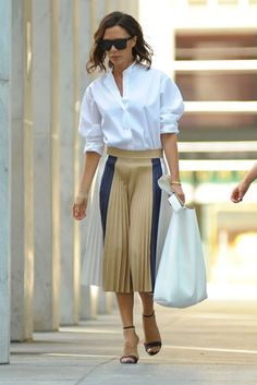 Daily Style Directory: Victoria Beckham in a white shirt and pleated skirt