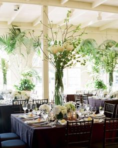 Soaring Bells of Ireland, native dogwood branches, and tulips are anchored by a trio of simple flower groupings.