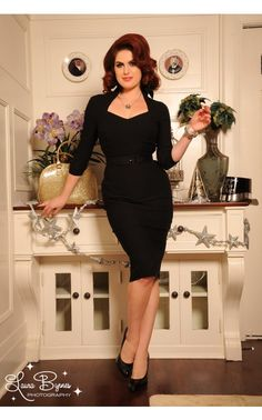 Pinup Couture- Vintage Goth Pinup Capsule Collection- Lorelei Dress in Black Bengaline  the Lorelei is an incredibly flattering and sophisticated wiggle dress made in soft bengaline fabric that loves your curves and is unbelievably comfortable, too. With beautiful seaming, cuffed three-quarter sleeves, gorgeous dark green color, and a collar that can be worn up or down. The bodice is lined completely in stretch charmeuse for superior comfort and fit
