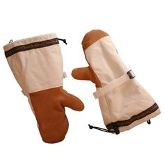 Plunge Mitts at Duluth Pack - Durable 10-ounce tightly woven cotton duck canvas. Canvas is highly wind resistant, breathable, preshrunk, and untreated. Soft-tanned leather palms and thumbs. Removable liners are full-length and made of thick blanket wool. Cut full at the gauntlet to cover coat sleeves. Pull-cord near opening of gauntlet helps to seal out snow and wind. Cinch strap around wrist allows mitt to be tightened securely to ensure good fit. Guaranteed for Life. Made in USA. $90.00