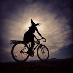 For some reason I love this pic. Is her bike seat a broom?  Too cute!