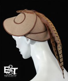 Hat: 1952, felt with pheasant feathers and bead trim.
