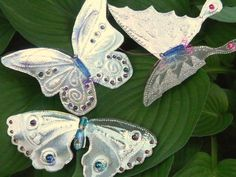 Embellish your Punched Tin(gutter flashing, pie plates, etc.) Designs whether they are Butterflies or Garden Markers with beads, wire, and jewelry tools. Detailed DIY.