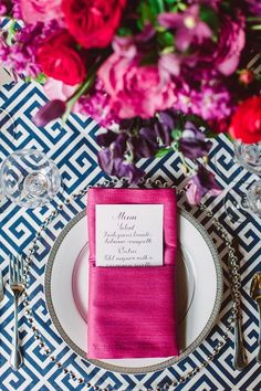 pink and red wedding flowers and white and navy print table linen