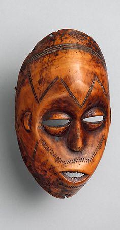 Africa | Bwani / Lukungu mask from the Lega people of the Shabundu region of DR Congo | Ivory | ca. 19th - 20th century
