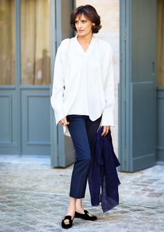 White blouse, navy trousers, and loafers