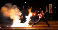 Fire back A demonstrator in Ferguson, Missouri throws back a tear gas container on Aug. 13, 2014 after police worked to break up a group of bystanders who were protesting the death of 18-year-old Michael Brown.